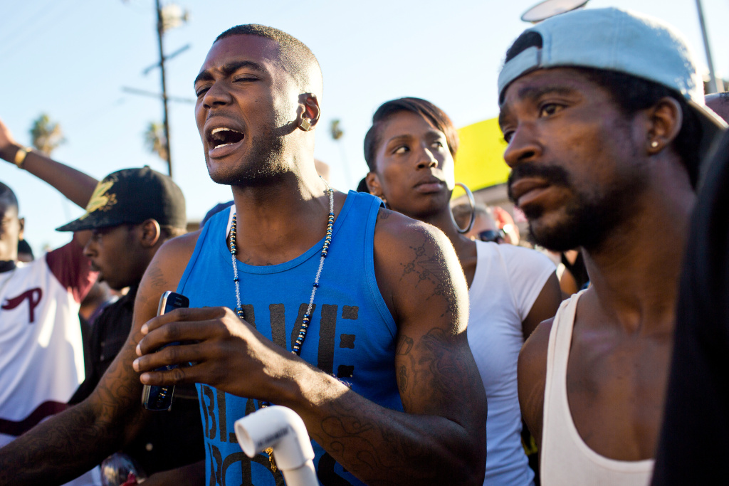Younger brother Lavell Ford yells at officers from the 77th Division to back up during a march on Thursday evening, Aug. 14 for 25-year-old Ezell Ford who was fatally shot by Los Angeles police on Aug. 11. The march began at West 65th Street where Ford was shot and travelled down South Broadway to LAPD's 77th Division.