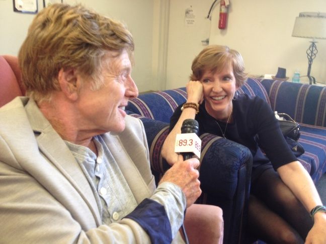 Robert Redford using Molly Peterson's microphone to interview the president of Pitzer College about climate divestment on Saturday, April 12, 2014.