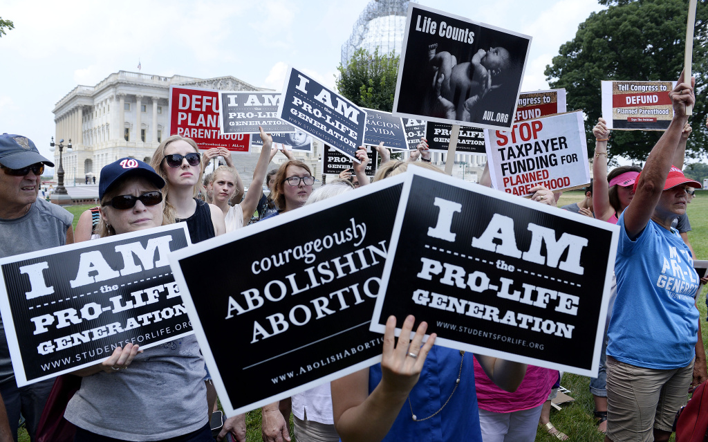 WASHINGTON, DC - JULY 28: Anti-abortion activists hold a rally opposing federal funding for Planned Parenthood in front of the U.S. Capitol on July 28, 2015 in Washington, DC.