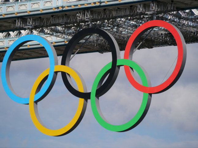 The Olympic rings on Tower Bridge in England.