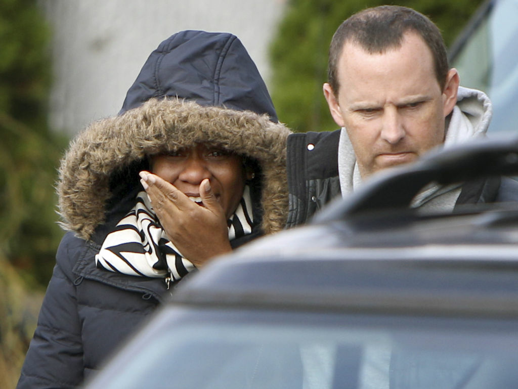 Glenda Moore, and her husband, Damian Moore, react as they approach the scene where at least one of their childrens' bodies were discovered in Staten Island, New York, Thursday, Nov. 1, 2012.