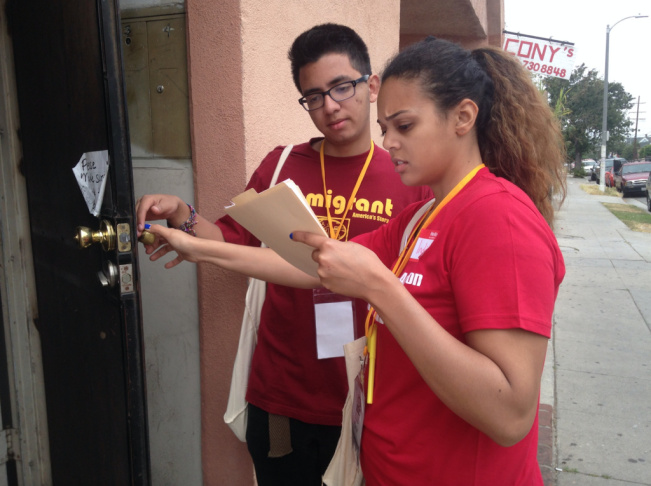 Volunteers Rodrigo Beteta and India Warren do last-minute, get-out-the-vote canvassing for the Coalition for Humane Immigrant Rights of Los Angeles in West Adams on Tuesday morning.