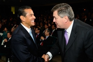 Los Angeles Mayor Antonio Villaraigosa greets Tim Leiweke, President and CEO of AEG, during an event announcing naming rights for the new football stadium Farmers Field at Los Angeles Convention Center on February 1, 2011 in Los Angeles, California.