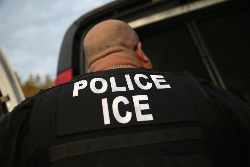 A U.S. Immigration and Customs Enforcement agent detains an immigrant in Los Angeles.