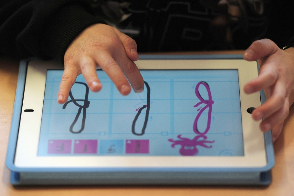 A nursery school pupil works with a tablet computer, on March 18, 2013 in Haguenau, northeastern France.