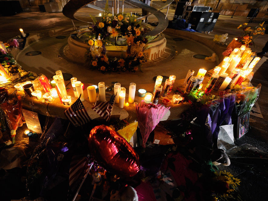 Mourners create a memorial at the fountain of the Aurora Municipal Center after a prayer vigil Sunday for the 12 victims of Friday's mass shooting at the Century 16 movie theater. National politicians are shying away from serious gun control debates after the tragedy, afraid to take on the powerful gun lobby.