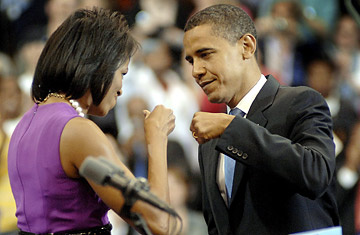 President Obama and First Lady Michelle Obama, with their signature gesture.