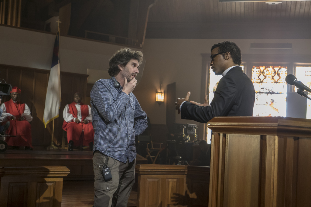 Director Joshua Marston with Chiwetel Ejiofor (playing Bishop Carlton Pearson) on the set of the Netflix movie