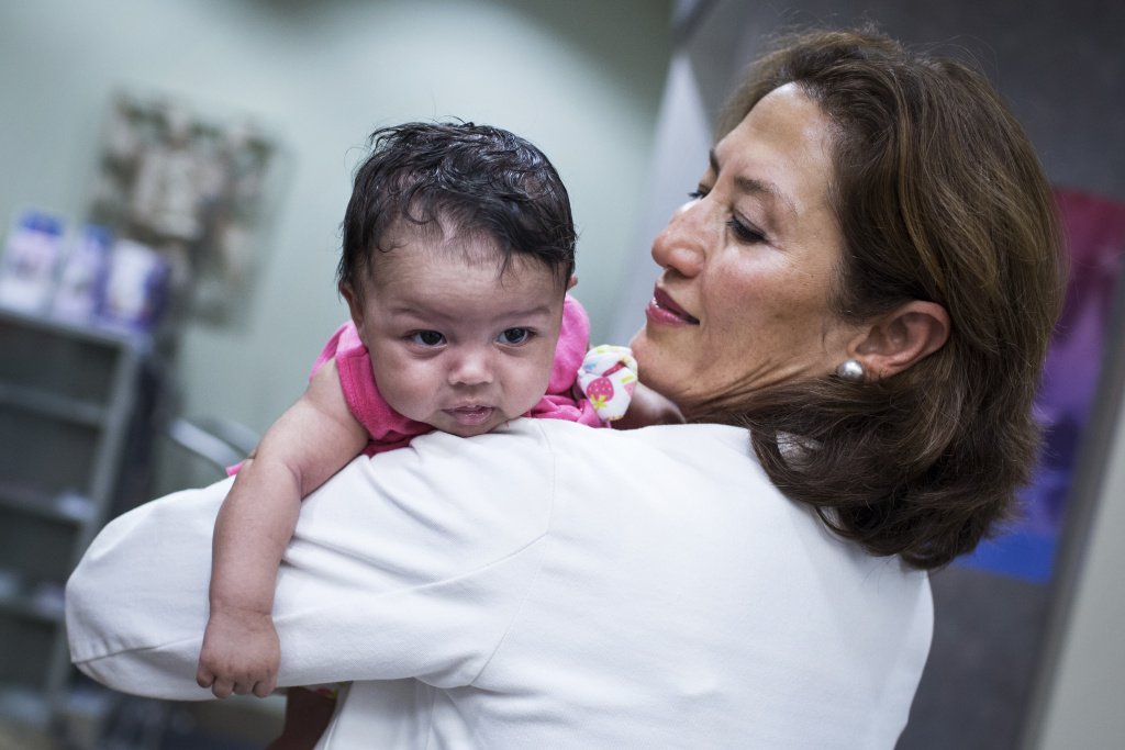 Dr. Fatma Batuman, medical director of the women's health program, holds 1-month-old Nyia Yvette Cavanagh at the at the VA West Los Angeles Medical Center on Wednesday afternoon, July 6, 2016. Both Cavanagh's parents are former Marines.