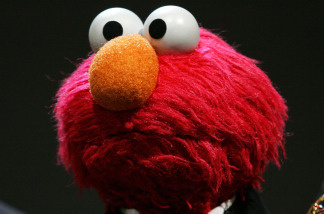 It ain't easy savin' green. Mitt Romney sees a future that includes advertisements on 'Sesame Street.'
