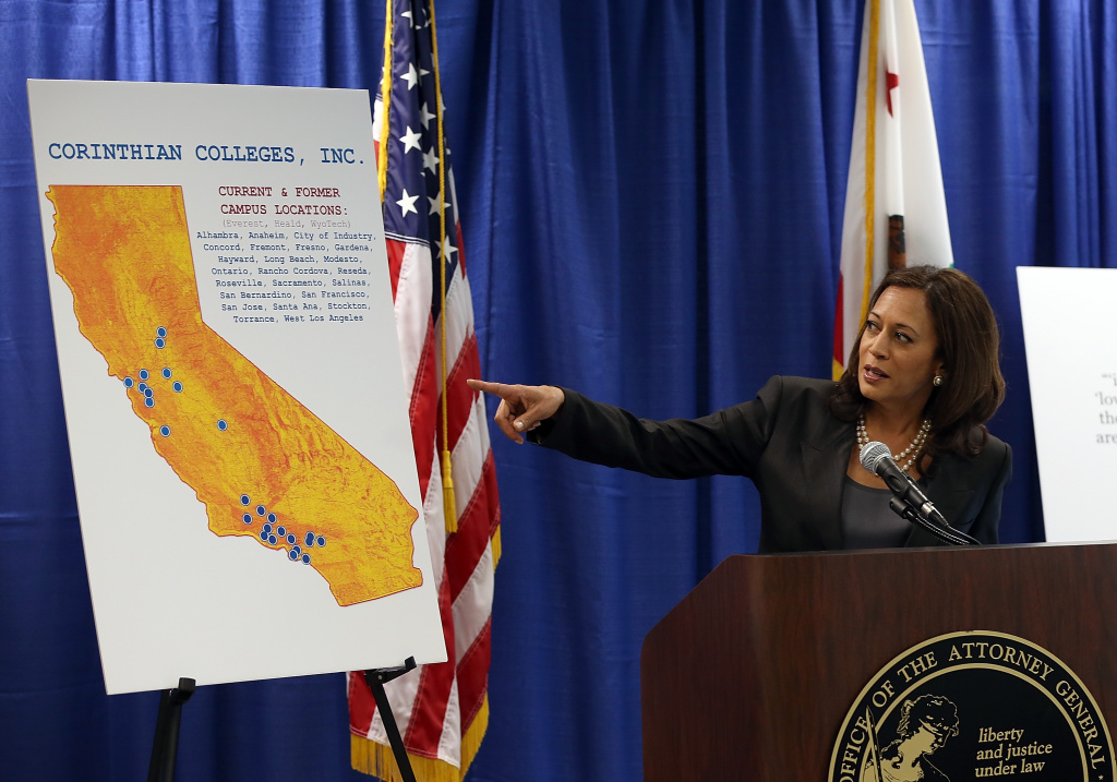 California Attorney General Kamala Harris points to a map as she speaks during a news conference on October 10, 2013 in San Francisco, California. Harris announced the filing of a lawsuit against the for-profit Corinthian Colleges and its subsidiaries for alleged false advertising, securities fraud, intentional misrepresentations to students and the unlawful use of military insignias in advertisements. Santa Ana, California-based Corinthian Colleges operates 111 total campuses in North America with 24 Heald, Everest and WyoTech colleges in California that have an estimated 27,000 students.