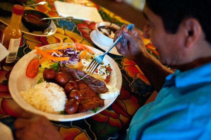 Masero Lopez eats lunch at Guelaguetza. The restaurant is known for its mole and Mezcal selection.