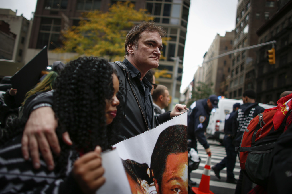 In this file photo, director Quentin Tarantino attends a protest to denounce police brutality in Manhattan October 24, 2015 in New York City. The rally was part of a three-day demonstration against officer-involved abuse and killing.