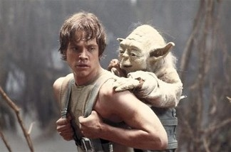 A 1980 publicity image originally released by Lucasfilm Ltd., shows Mark Hamill as Luke Skywalker and the character Yoda in this scene from 'Star Wars Episode V: The Empire Strikes Back.'