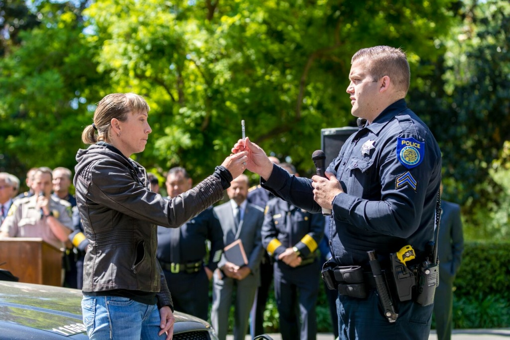 A police officer demonstrates a new oral swab test to detect drugged driving at a Sacramento event hosted by California Assemblyman Tom Lackey.