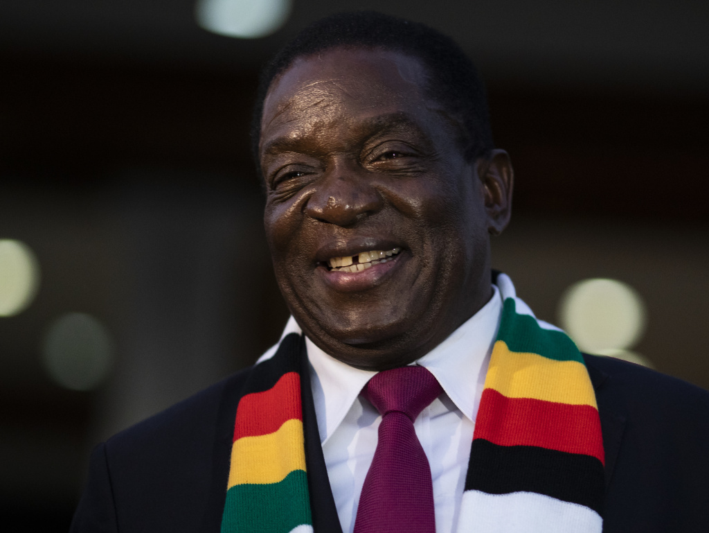 President Emmerson Mnangagwa smiles for photographers after a news conference earlier this month in Zimbabwe's capital, Harare.