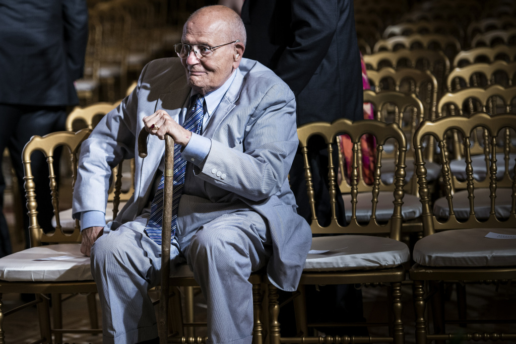 Representative John Dingell (D-MI) sits after listening to US President Barack Obama make a statement in the East Room of the White House July 18, 2013 in Washington, DC. Obama spoke about the Affordable Care Act.