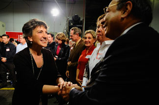 Republican candidate for U.S. Senate Carly Fiorina greets supporter Dr. Reza Karkia (R) during a town hall meeting Aranda Tools Inc. during a campaign event on October 6, 2010 in Huntington Beach, California.