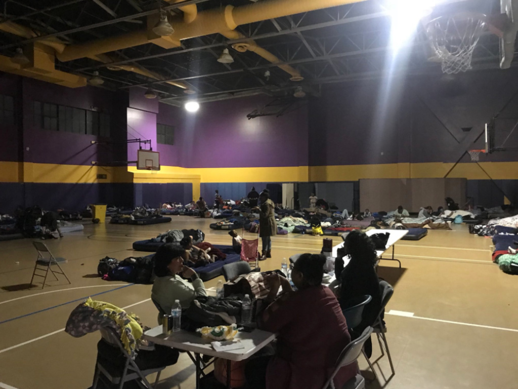 The gym at the Union Rescue Mission in Downtown LA has been used as shelter for some of the women and children evacuated from the Hope Gardens Family Center.