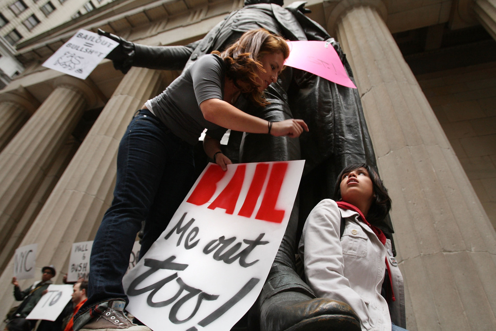 People rally in front of the New York Stock Exchange in the financial district against the proposed government buyout of financial firms September 25, 2008 in New York City.
