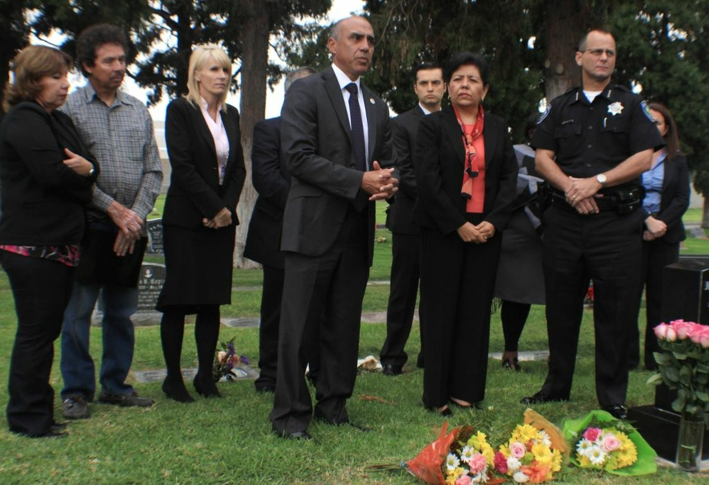 San Bernardino County authorities gathered at a Colton cemetery to honor victims of domestic violence in October 2013.