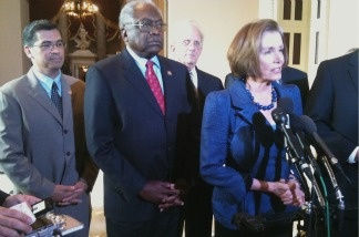 House Minority Leader Nancy Pelosi (right), flanked by LA Democrat Xavier Becerra(left), Congressman James Clyburn (center), and Van Nuys Democrat Howard Berman (back center).