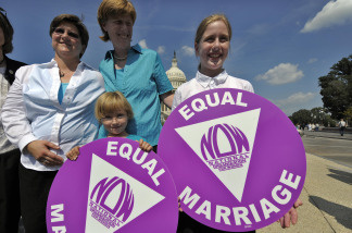Jen and Dawn Barbouroske (L) and their daughters McKinley and Bre  pose at a news conference with same-sex couples who asked to repeal the Defense of Marriage Act in Washington, DC, on September 15, 2009.