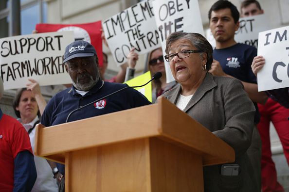 Washington, D.C. Councilmember Anita Bonds (D- At Large) (R) speaks as President of Metropolitan Washington Labor Council of AFL-CIO Joslyn Williams, farm workers and their supporters listen during a news conference in front of the John A. Wilson District Building May 5, 2015 in Washington, DC.