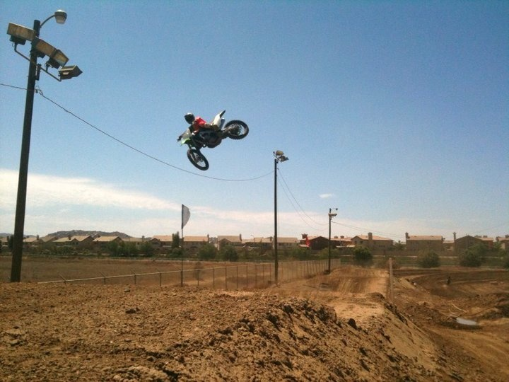 Connor Penhall flies over the track in the dusty Mojave Desert town of Adelanto. The celebrity son, killed by a drunk driver, rode motorcycles like his father, Hall of Famer Bruce Penhall.