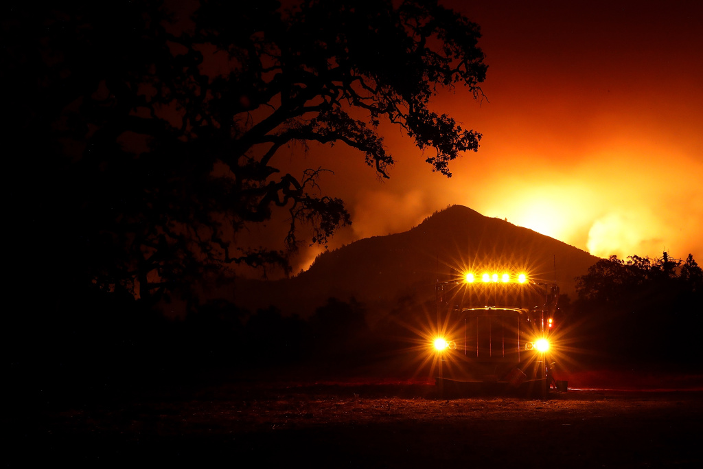 A fuel truck sits in a staging area as the Nuns Fire burns in the hills of Kenwood, California on October 10, 2017.