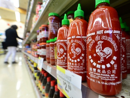 Bottles of Sriracha chili sauce on the shelves of a supermarket in Rosemead.