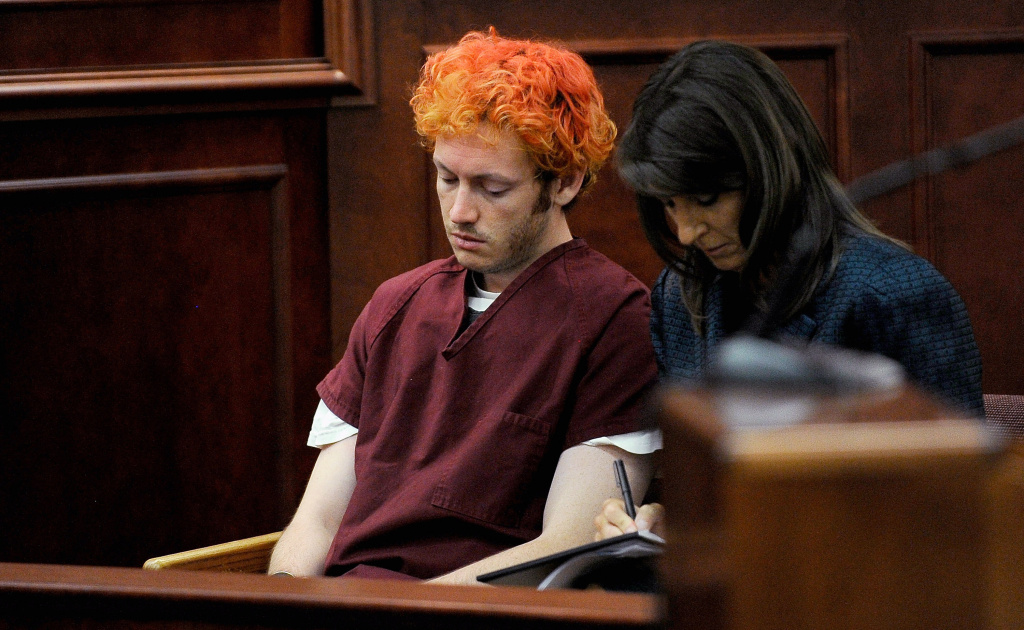 James Holmes (L) makes his first court appearance at the Arapahoe County Courthouse with his public defender Tamara Brady on July 23, 2012 in Centennial, Colorado.