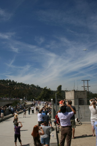 Space Shuttle Endeavour flying over crowds at Devils Gate Dam in Pasadena.