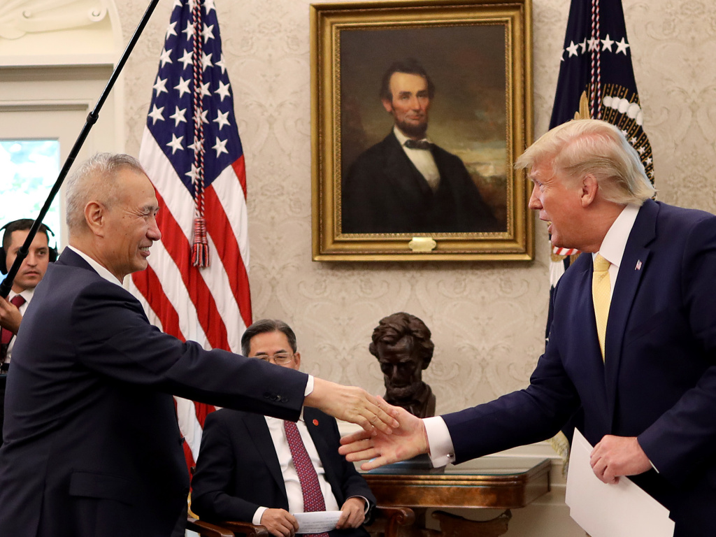President Trump shakes hands with Chinese Vice Premier Liu He at the White House after announcing a
