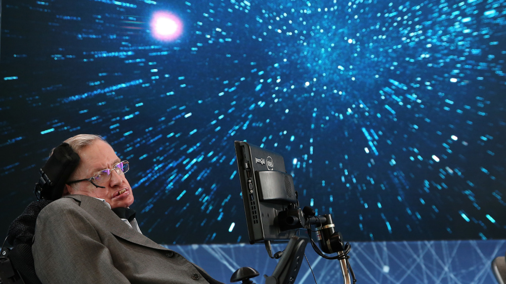 Professor Stephen Hawking sits onstage during the