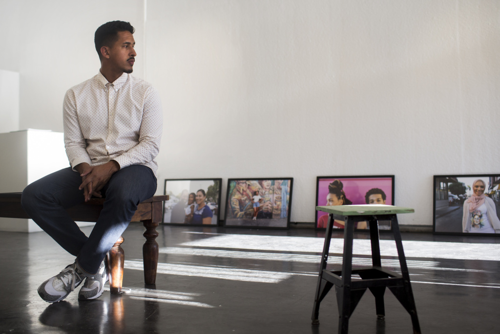 Photographer Walter Thompson-Hernandez sets up his new show,