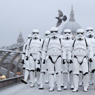 "People dressed as Stormtroopers from the Star Wars franchise of films pose on the Millennium Bridge to promote the latest release in the series, ""Rogue One."""