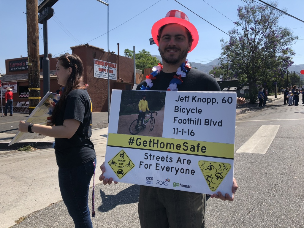 Kevin Knopp holds a sign featuring a photo of his dad, Jeff Knopp. His dad was killed while cycling on Foothill Boulevard almost two years ago. Now, he says there is a bike lane where his father, Jeff, was hit.