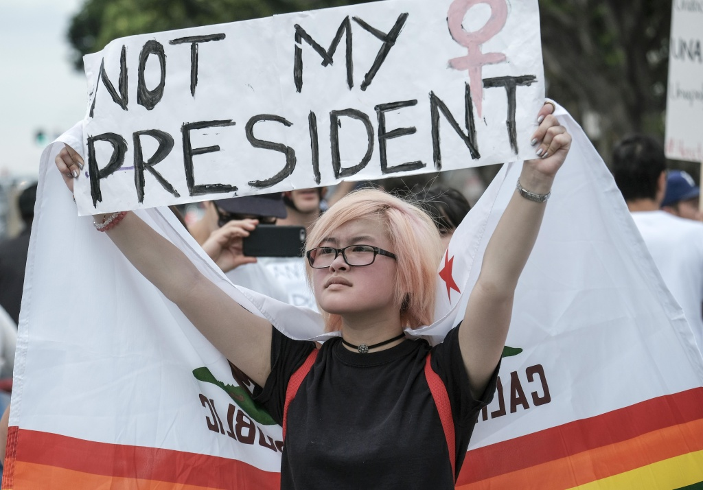 Demonstrators gather outside the Edward Roybal Federal Building to protest against US President-elect Donald Trump in Los Angeles on November 12, 2016.
