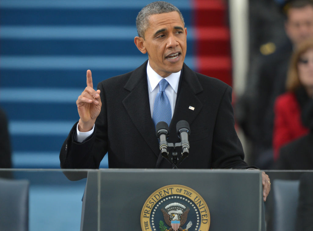 US President Barack Obama addresses the audience after taking the oath of office during the 57th Presidential Inauguration ceremonial swearing-in at the US Capitol on January 21, 2013 in Washington, DC. US Chief Justice John Roberts administered the oath.