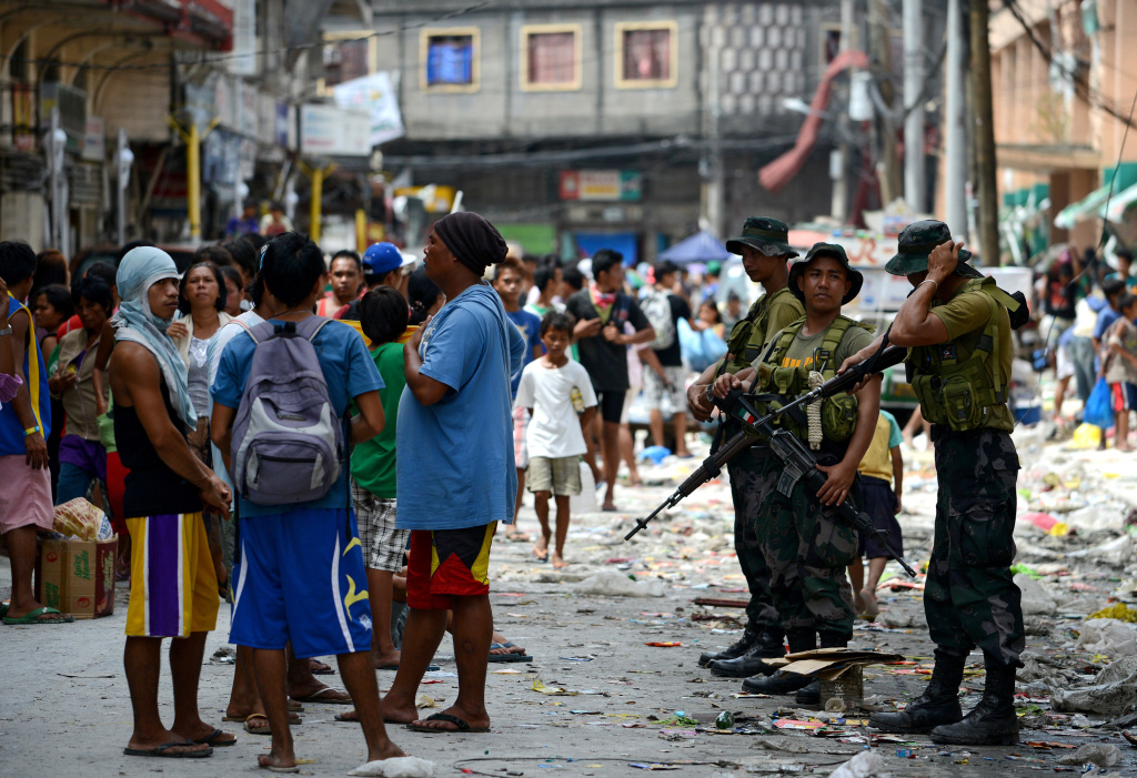 Philippine police and soldiers are deployed to stop rampant looting in the aftermath of Super Typhoon Haiyan in Tacloban in the eastern Philippine island of Leyte on November 11, 2013. The United States, Australia and the United Nations mobilised emergency aid to the Philippines as the scale of the devastation unleashed by Super Typhoon Haiyan emerged on November 11.