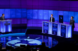 Contestants Ken Jennings and Brad Rutter compete against 'Watson' at a press conference to discuss the upcoming Man V. Machine 'Jeopardy!' competition Jan. 13, 2011.