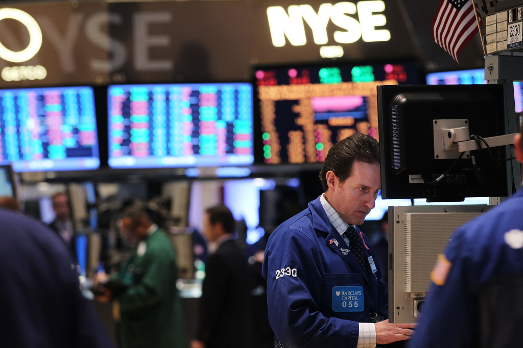 Traders work on the floor of the New York Stock Exchange on January 13, 2012 in New York City.