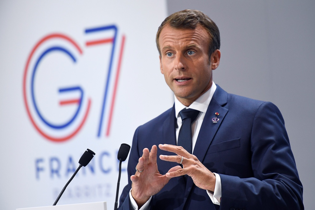 France's President Emmanuel Macron  gives a press conference   in Biarritz, south-west France on August 26, 2019