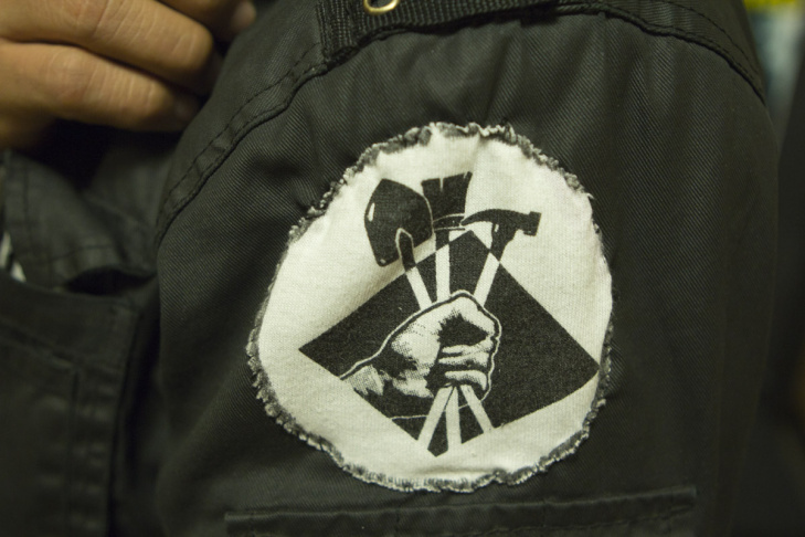 Cárdenas shows off the patch on his jacket for VOZ Workers Rights Education Project, the day laborer group that he represents.