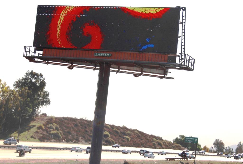 The billboard is located along Interstate 15 in Corona.