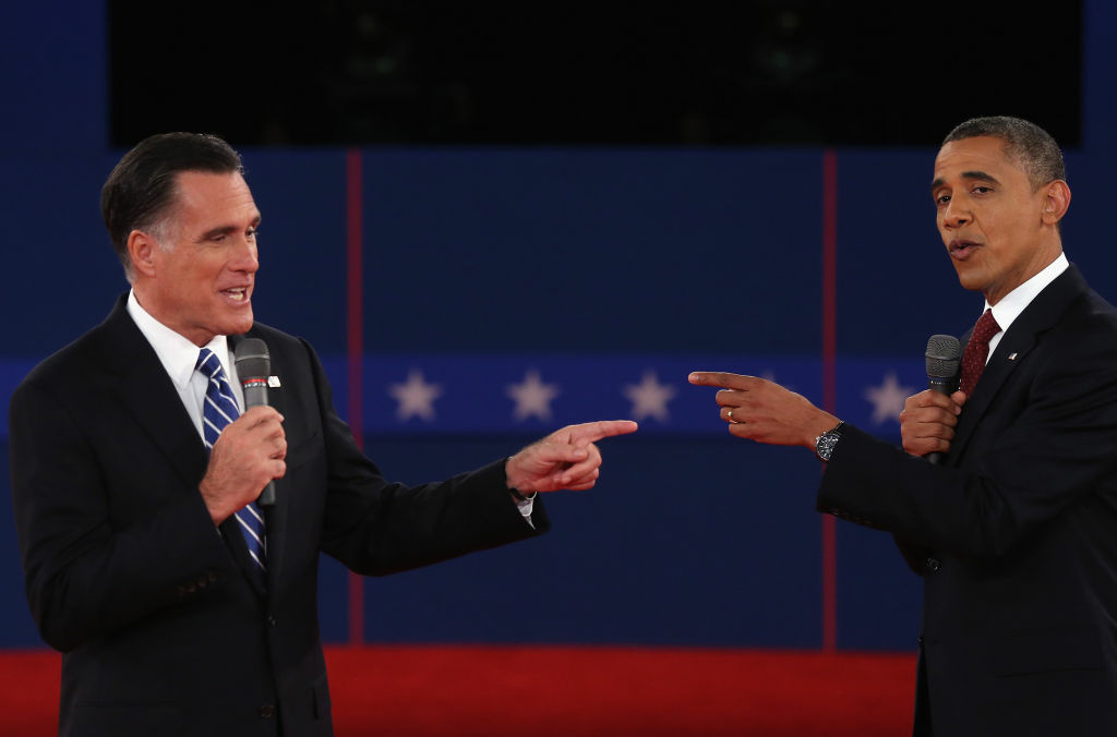 Republican presidential candidate Mitt Romney (L) and U.S. President Barack Obama talk to each other during a town hall style debate at Hofstra University October 16, 2012 in Hempstead, New York.