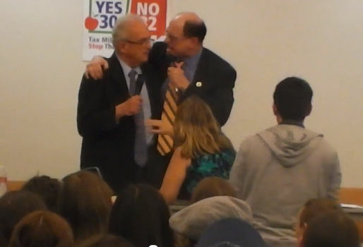 Congressman Brad Sherman swings his arm around Congressman Howard Berman during a debate Thursday night, October 11 in the San Fernando Valley.