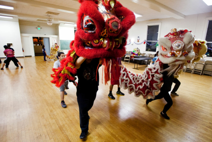 The Immortals members Alex Dea, 16, left, and Amie Truong, 15, practice lion dancing at Ynez Elementary School in Monterey Park on Friday, Jan. 25. The troupe performs in weddings, parades, commercials, and other special events.