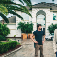 Andrew Garfield stars as 'Dennis Nash' and Michael Shannon as 'Rick Carver' in Broad Green Pictures release, 99 HOMES.